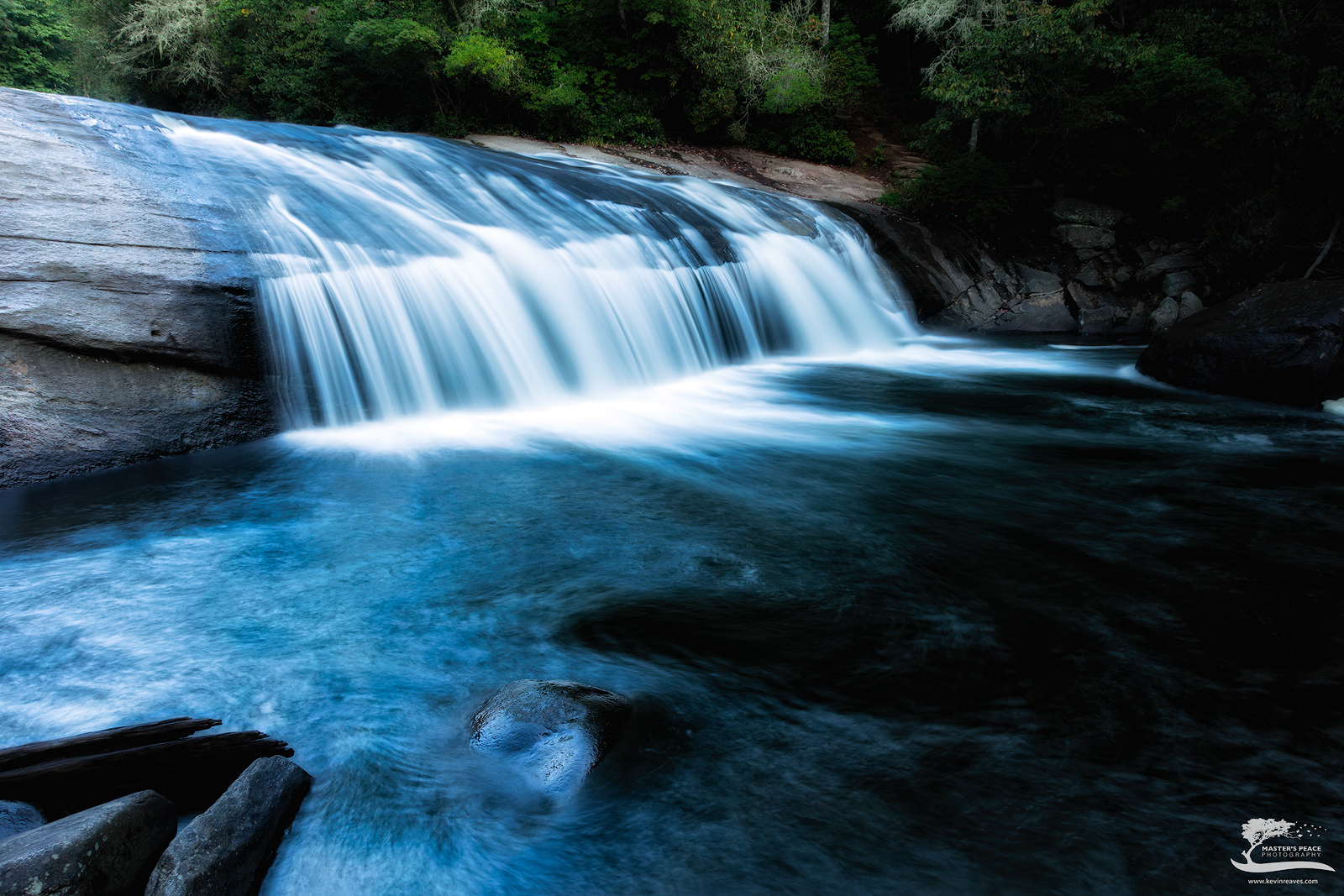 This little falls is sandwiched between some of the bigger falls on the Horsepasture River. It is easily accessible down...